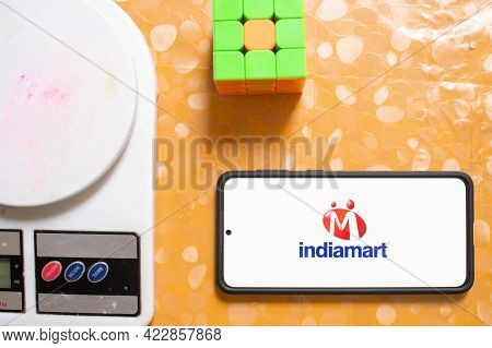 Indiamart Intermesh B2b Marketplace Ipo Company In India With Digital Weighing Scale And Rubiks Cube