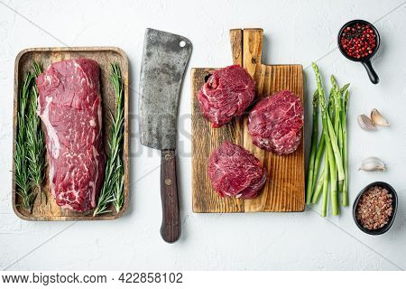 Fillet Mignon Tenderloin Raw Meat Veal  And Beef Steaks Set, On Wooden Cutting Board, On White Stone