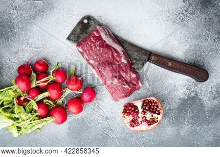 Raw Beef Fillet Steaks With Spices And Whole Marbled Tenderloin Cut Set, On Old Butcher Cleaver Knif