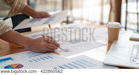 Business Man Investment Consultant Analyzing Company Annual Financial Report Balance Sheet Statement
