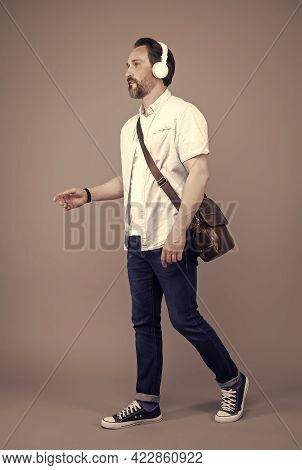 Dont Stop Music. Bearded Man Listen To Music On Foot. Mature Person Wear Headphones Playing Music. C