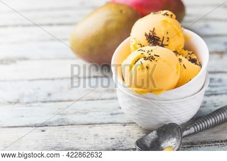 Homemade Mango Ice Cream In A Bowls With Fresh Fruits Over White Wooden Background.