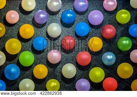 Rows Of Large Number Of Colorful Balloons On A Black Background, Beautiful Pattern. Close-up. Select