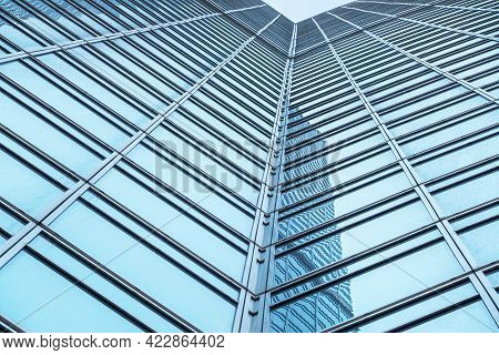 Moscow, Russia - April 13, 2021: Bottom View Of The Facade Of A Modern Glass Building With Reflectio