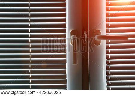 Office Blinds. Modern Jalousie On The Windows In The Room. Sunlight