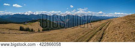 Carpathian Mountain Plateau Spring Panorama With Country Road, Ukraine.