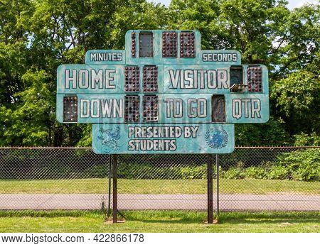 An Old Football Scoreboard On A Field In Swissvale, Pennsylvania, Usa On A Sunny Day