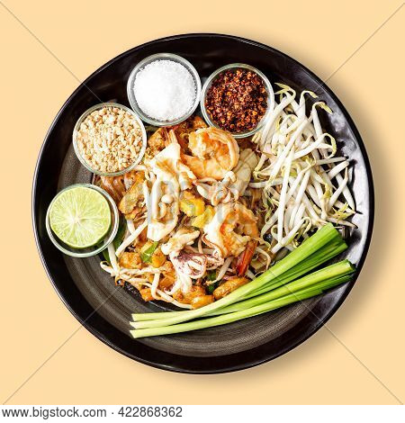 Thai Fry Noodle With Shrimp, Pad Thai Is Famous Street Food For Thailand, Isolated On Cream Backgrou