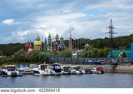 View Onto Temple Of All Religions & Boat Pierce From River Volga Side, Kazan, Russia. Temple Is Uniq