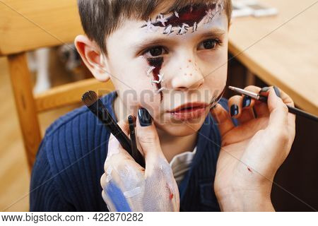 Little Cute Child Making Facepaint On Birthday Party, Zombie Apocalypse Facepainting, Halloween Prep