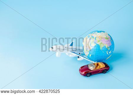 Airplane, Car And Globe On Blue Background. Summer Or Vacation Concept. Copy Space