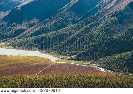 Wonderful Alpine Landscape With Small Houses On Hill Near Lake And River In Mountain Valley With For