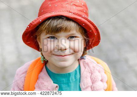 Portrait Little Preschool Girl Going To Playschool. Healthy Toddler Child Walking To Nursery School