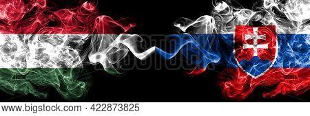 Hungary, Hungarian Vs Slovakia, Slovakian Smoky Flags Side By Side.