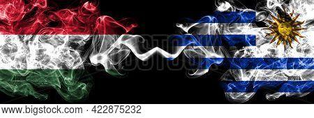 Hungary, Hungarian Vs Uruguay, Uruguayan Smoky Flags Side By Side.