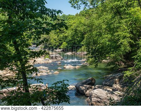 Visitors And Families Swim In The River At The Audra State Park Near Buckhannon In West Virginia