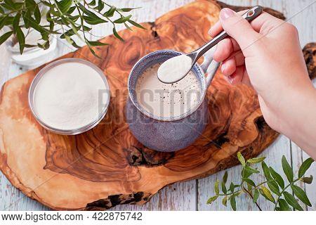 Woman Adding Collagen Powder To Her Morning Coffee. Beauty Collagen Supplement, Additional Collagen