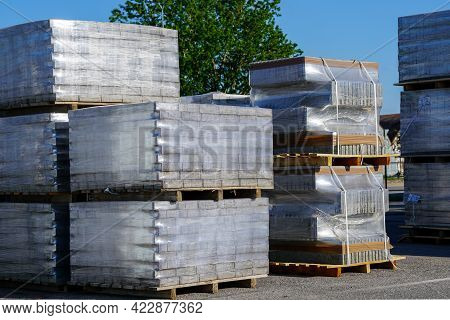 Pallets Stacked With Cobblestones Wrapped In Transparent Plastic Film