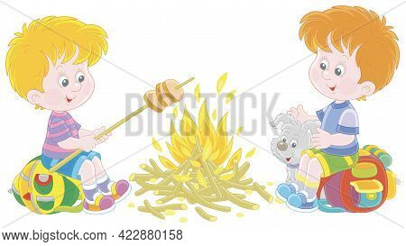 Little Boy-scouts With A Small Pup In A Forest Camp, Friendly Smiling, Talking And Roasting Bread On