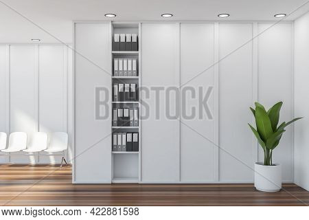 Waiting Room Interior With White Chairs On Parquet Floor And Plant In Pot. White And Wooden Room In