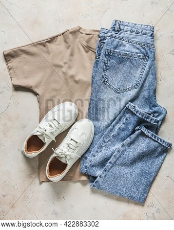 Women's Casual Walking Wear - Comfortable Leather Sneakers, Beige T-shirt And Blue Jeans On A Light