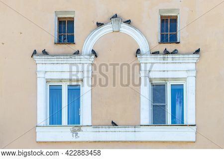 Facade With Pigeons Over The Arch To The Railway Station In The City Of Vladimir, Central Russia