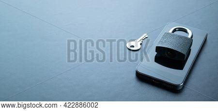 Internet Protection. Modern Space Grey Mobile Phone With Padlock, Key On Dark Background. Darkweb, D