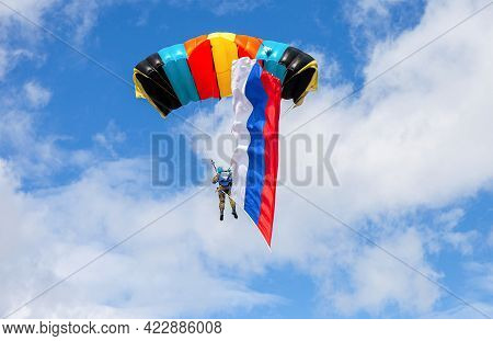 Parachute Jumper With Flag Of Russia On A Blue Sky Background