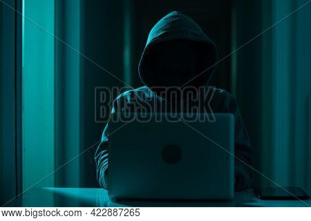 Identity Theft - Hacker Using Laptop. Hacking The Internet. Network Security And Electronic Banking
