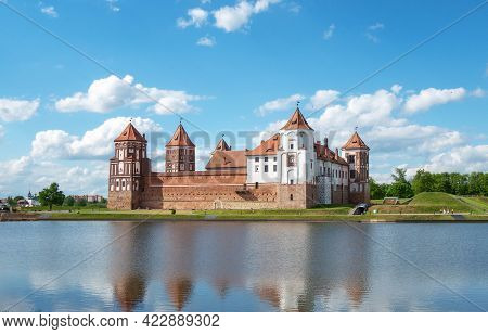 Ancient Castle In The City Of Mir In Western Belarus With Reflection In The Lake.