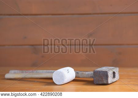 Old Vintage Hammer And Mallet Lie On A Wooden Workbench, Tools