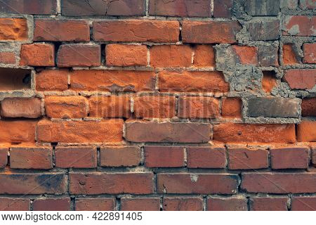 Wall Of Old Red Clay Bricks. Ruined Vintage Stone Background. Rough Aged Masonry Backdrop. Surface O