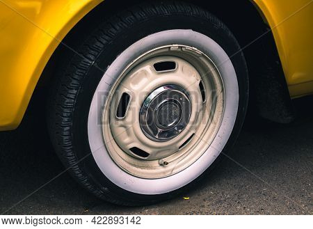 Retro Car Festival. Tire Of An Old Retro Car. Fragment Of The Front Of A Retro Car. The Old Car Has