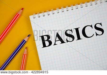 Basic Written On White Notepad And Yellow Background