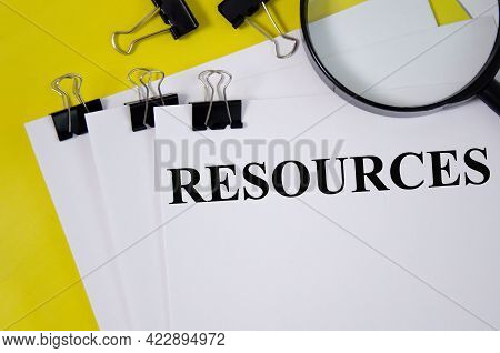 Resource Word Written On White Paper And Yellow Background With Magnifier