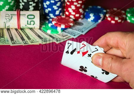 Poker Cards With Three Of A Kind Or Set Combination. Close Up Of Gambler Hand Takes Playing Cards In