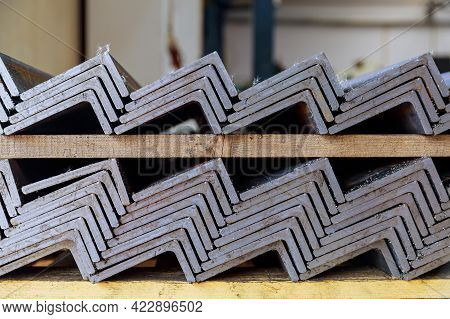 Rolled Metal Products, L-profile. A Stack Of Angle Steel In A Factory. Metal Profile After Cutting W