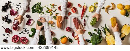 Flat-lay Of Human Hands Keeping Bottles With Fresh Juices