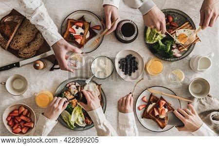 Flat-lay Of Peoples Hands With Toasts And Snacks For Breakfast