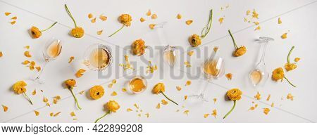 Flat-lay Of Trendy Orange Or Amber Wine And Yellow Flowers