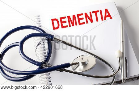 Notebook With Text Dementia With Pen And Stethoscope, Medicina