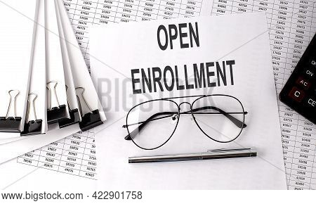 Open Enrollment Text On Paper With Chart And Office Tools , Business