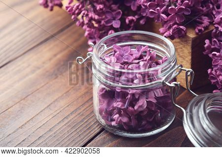 Lilac Flowers In A Jar, Bunch Of Purple Syringa Flowers On Background. The Preparation Of Infusion,