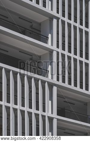 Low Angle View Of Concrete Sunshades Wall With Terrace Of Modern High Residential Building In Vertic