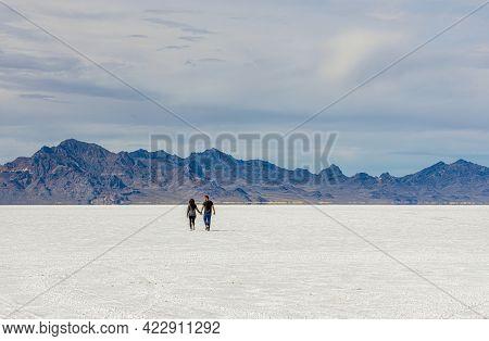 Bonneville Salt Flats, Utah - May 30, 2021:  People And Cars Enjoying The Flats