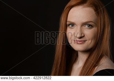 Candid Portrait Of Happy Young Woman With Charming Smile And Gorgeous Red Hair On Dark Background, S