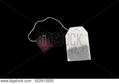 Tea Bag Isolated On Black Background With Clipping Path. Close-up Of Fresh Herbal Tea Bag Isolated O