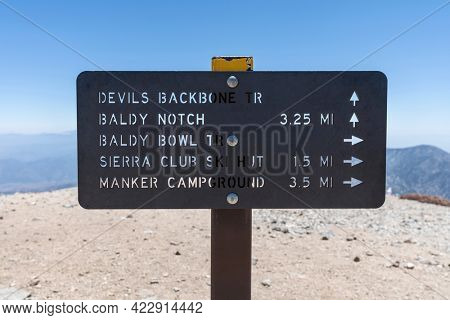 Mt Baldy, California, USA - May 23, 2021:  View of Devils Backbone trail sign on the summit of Mt Baldy in the San Gabriel Mountains.