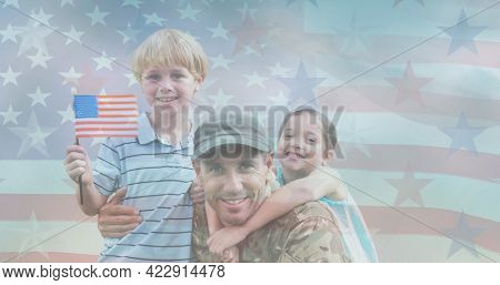 Composition of male soldier embracing smiling children over american flag. soldier returning home to family concept digitally generated image.