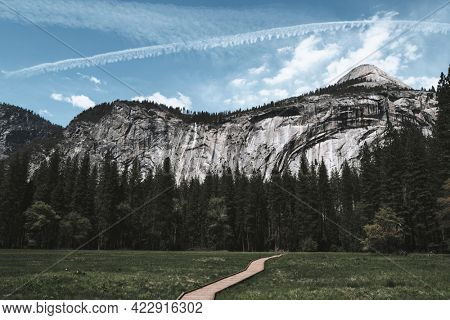 Contrails over the blue sky in Yosemite National Park, California